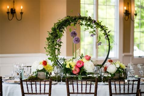 hoops with cascading greens and clematis allium and