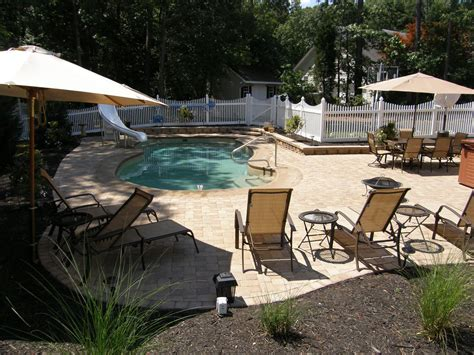 Pool Patios Designs Pool Patio Materials Sted Concrete Vs Pavers