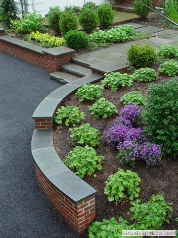 rock fence designs curved brick retaining wall with front yard plantings stone slab steps