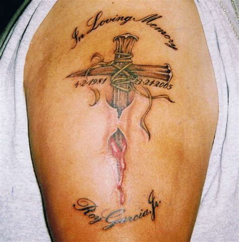 cross tattoo ripping out of skin skin tattoos gallery