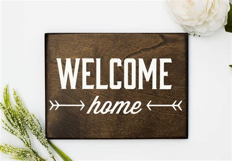 welcome home wooden sign handmade by honeysuckle and pine