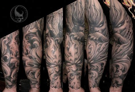 demon full sleeve tattoo by paul booth design of