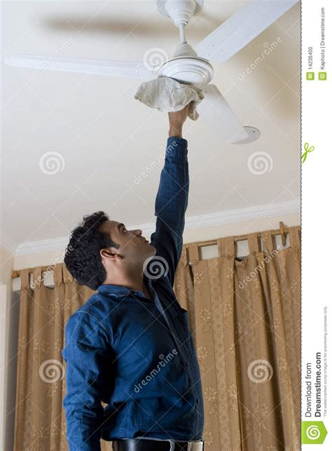 cleaning  ceiling fan stock photo image