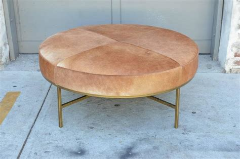 round coffee table with 4 ottomans chic natural hide and brass base round ottoman or coffee