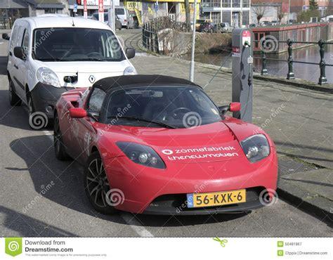 tesla charging electric car tesla charging at charging station editorial