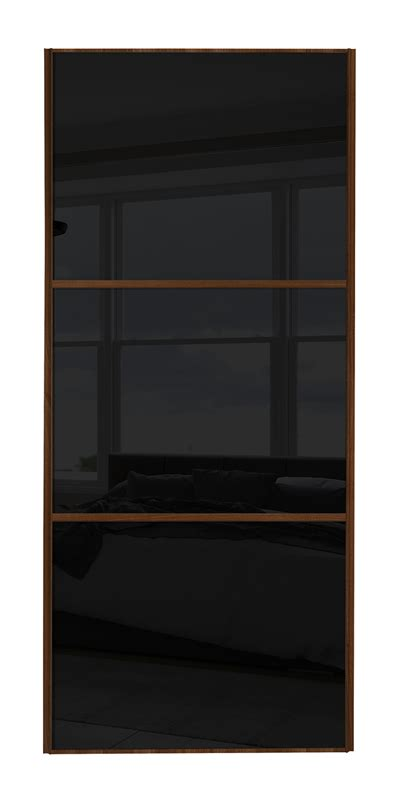 classic wideline door with walnut frame and black glass panels