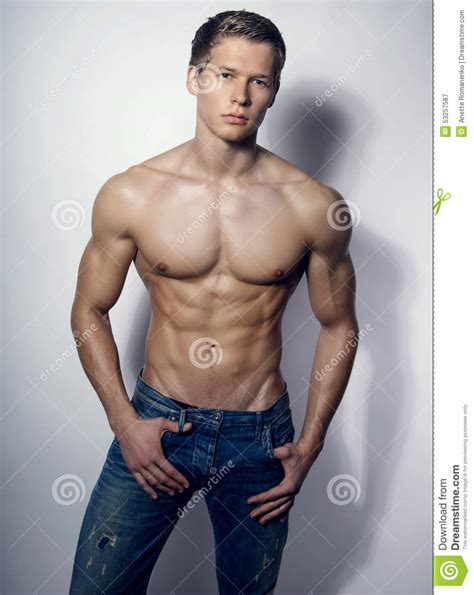 best stock photos of photo handsome man showing cell phone black handsome muscular young bodybuilder showing his muscles