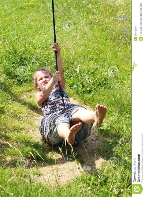 swinging on a swing barefoot girl on a swing royalty free stock photo image