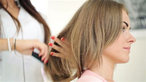 looking haircut specialist for illinois happy woman looking at her new haircut in hair salon stock