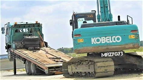 Alat Berat Kobelco alat berat kobelco sk200 excavator compactor moved by fuso