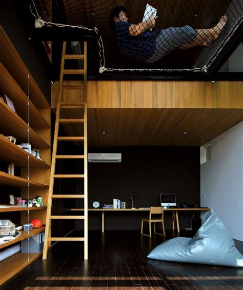 two floor bed two story room with suspended netting reading nook