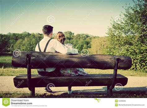 bench couple shirt young couple in love sitting on a bench in park vintage