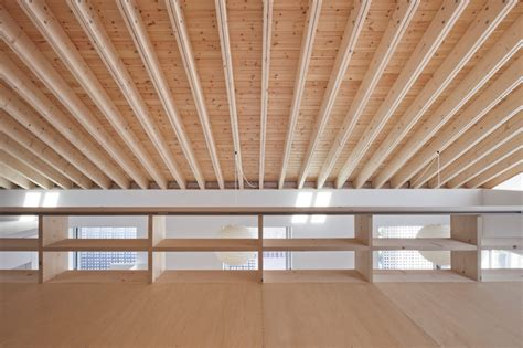 Rafter Ceiling by House With Exposed Timber Rafters And Bookshelf Columns