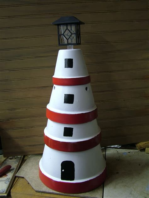 Lighthouse Made Out Of Flower Pots With Solar Light On Top Solar Lighthouse Light