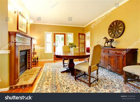 Mustard And Living Room by Living Room Fireplace Mustard Wall Color Stock Photo