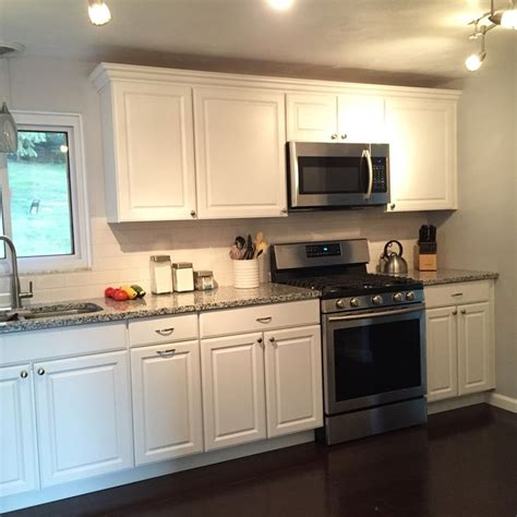 luna pearl granite with white cabinets loving our white cabinets luna pearl granite countertops