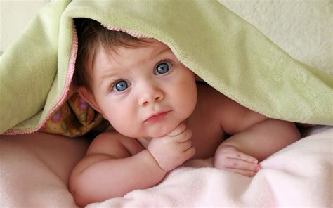 Cute baby under a soft blanket beautiful baby wallpapers 160x100