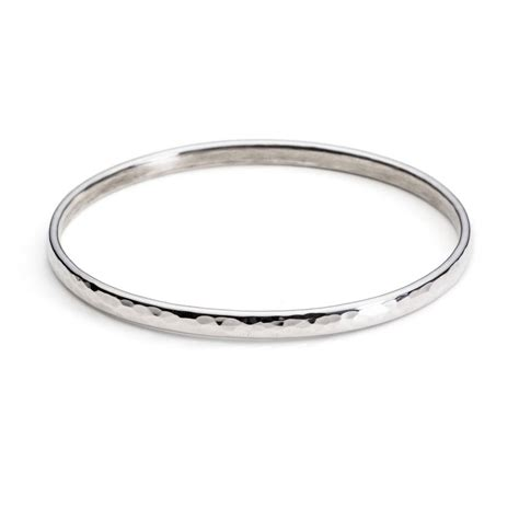Handcrafted Bangles - simple handmade hammered silver bangle by alison