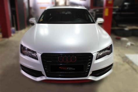 white wrapped cars car wrap dubai audi a7 wrapped in white pearl semi matte