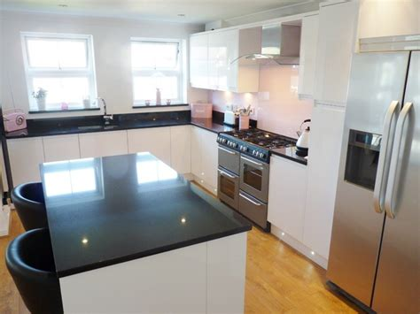 Retro Kitchen Worktops by White Gloss Handleless With Absolute Black Granite