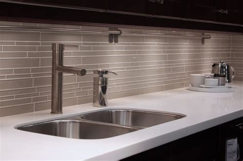 light gray subway tile backsplash random subway linear glass tile for a kitchen backsplash great kitchen details