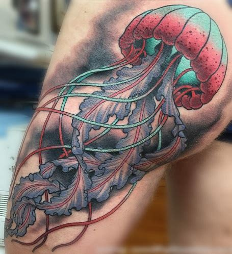 shoulder jellyfish tattoo by kwadron tattoo gallery top 9 famous jellyfish tattoos with images styles at life