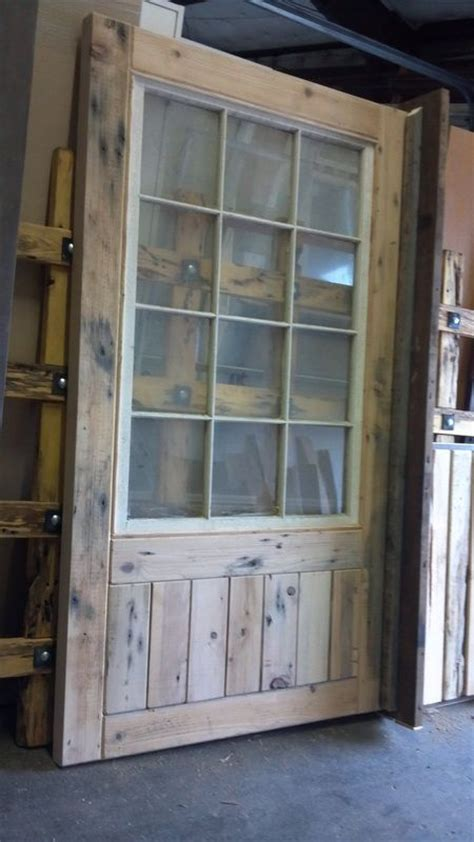 Swinging Barn Door With Windows For The East Bay Of The Barn Door Window