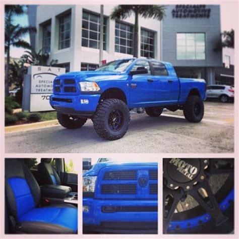 dodge ram blue lifted truck