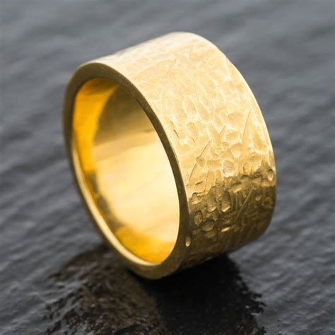panned 18ct eco gold heavy textured wedding ring by