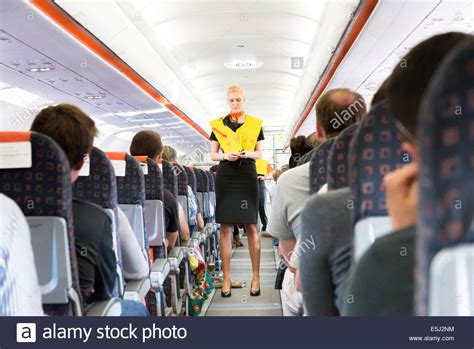 easy jet cabin crew easyjet cabin crew demonstrating use of lifejacket during