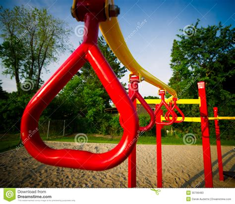 kk swing red swing bars on outdoor play structure stock image