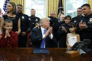 president trump oval office trump turns white house blue honors slain police officers