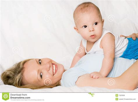 mom son bed happy mother with her son on the bed royalty free stock