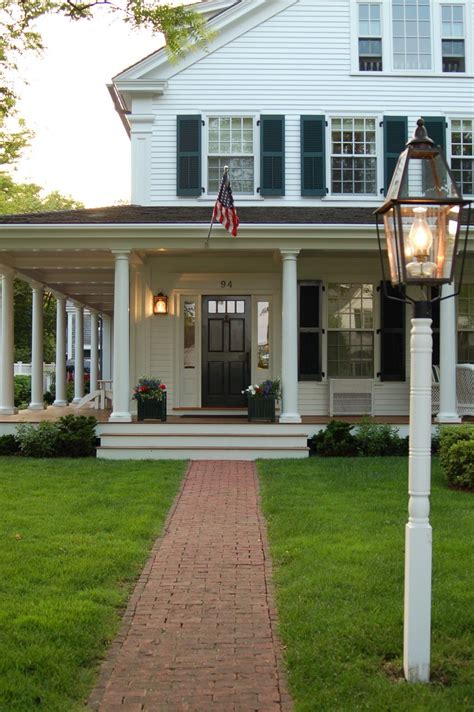 house with a porch traditional white house with black shutters and big front porch on martha s vineyard via bygone