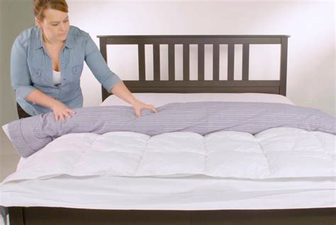 how to put a duvet cover on a down comforter video how to put on a duvet cover real simple