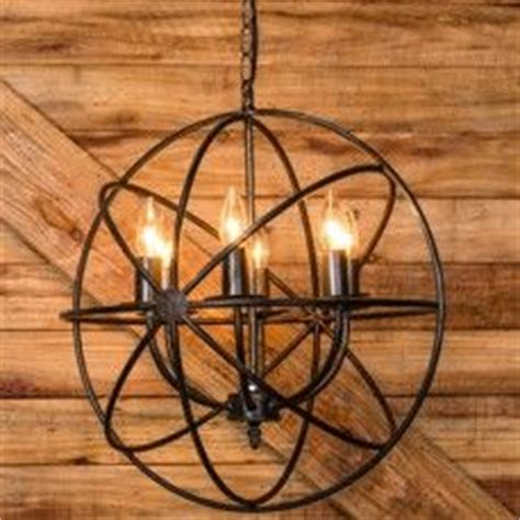 iron sphere light fixture 1000 ideas about wrought iron chandeliers on