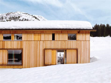 snow proofed hillside family home in austria dwell