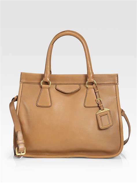 The Prada Calfskin Duffle Bag by Prada City Calfskin Handle Tote Bag In Brown