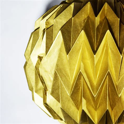 Shaped Paper Folding - gold geometrical shaped folding paper lantern