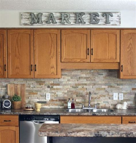 oak kitchen cabinet how to make a galvanized market sign stone backsplash