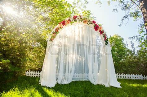 wedding arch term wedding arch on the grass stock photo colourbox
