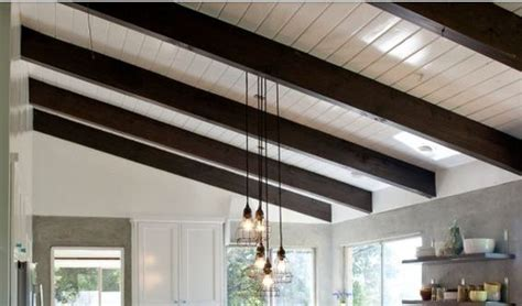 ceilings painted white  dark walnut stained exposed