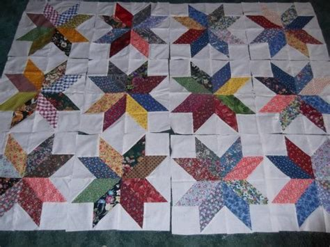 quilt pattern using 5 inch squares charm pack star makes a 16 inch block via craftsy free