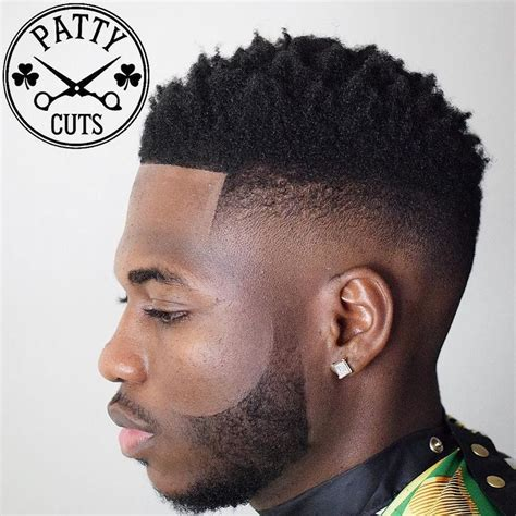 dope haircut parts well done fade finished off with detailed shape up of the