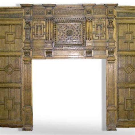 english tudor broke hall paneled room and fireplace surround