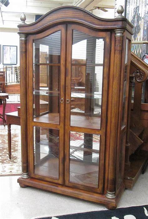 ashley furniture curio cabinet ashley serengeti kuliwood and leather curio cabine