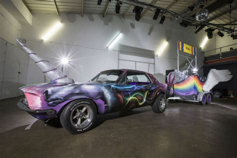 classic ford mustang transformed into rainbow coloured