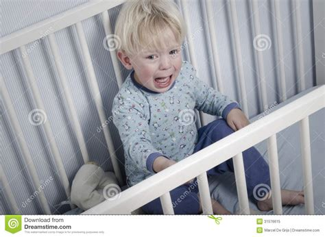 crying in bed crying boy in bed royalty free stock photo image 31576615