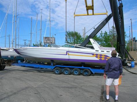 boat vinyl wrap darwin stinger 390 in the water offshoreonly