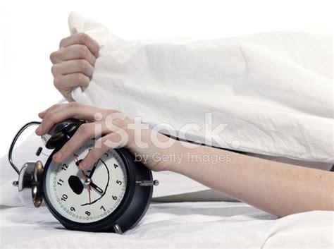 in bed rude awakening alarm clock stock photos freeimages